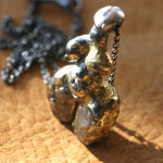 Senufa_2009_oxidized and carved fine silver and 22K gold pendant