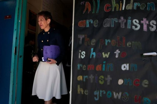 National Endowment for the Arts Chairman Jane Chu leaves a classroom after visiting with students at Martin Luther King Jr. Elementary School in Compton in 2015. (Los Angeles Times)
